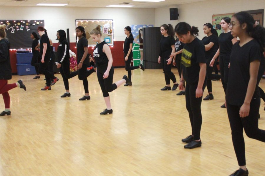 During 1st period Dance 1, the students are going over new tap steps that they've learned throughout the class.