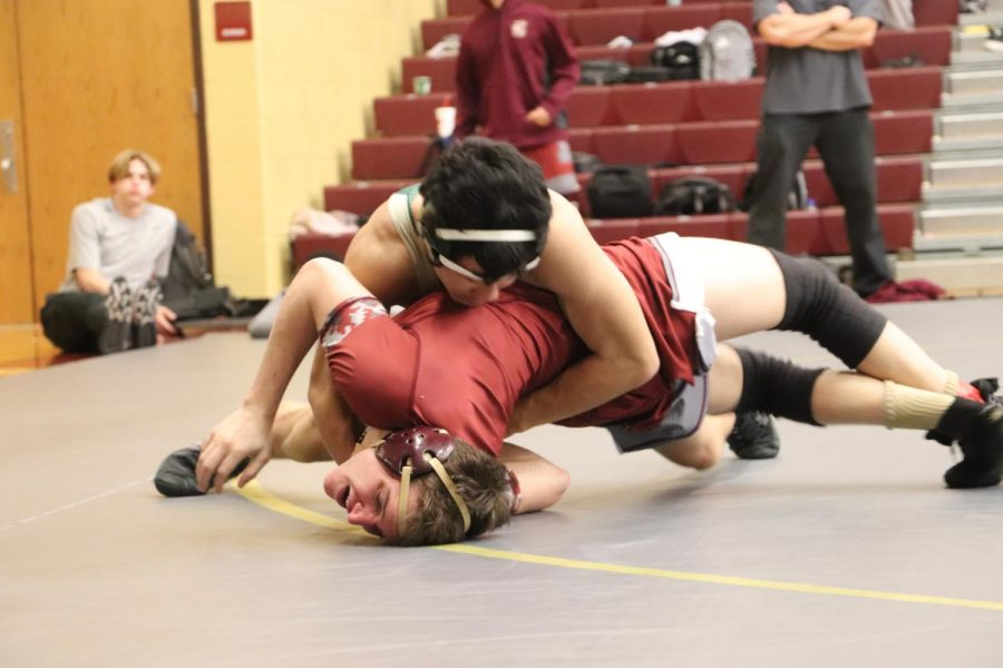 """Junior, Greyson Howard, says his best match was against Liberty High School. Wrestling """"gives [him] a purpose and allows [him] to focus more in class."""""""